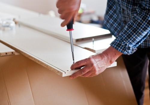 Man Assembling Flat Pack Furniture